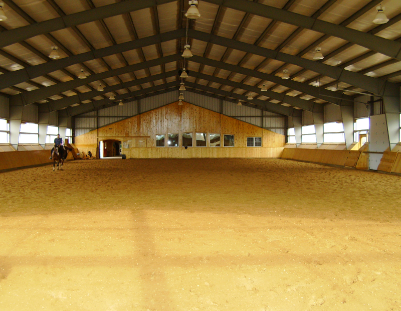 horse riding arena, indoor horse riding arenas, building horse riding arena, we cover, dutchmasters, ironwood building systems, fabric covered horse riding arena, wood post frame horse riding arena, lindsay day remt, steel frame horse riding arena, pre-engineered horse riding arenas, pre-built horse riding arenas, horse arena footing, pdi lasergrade, horse riding arena permit